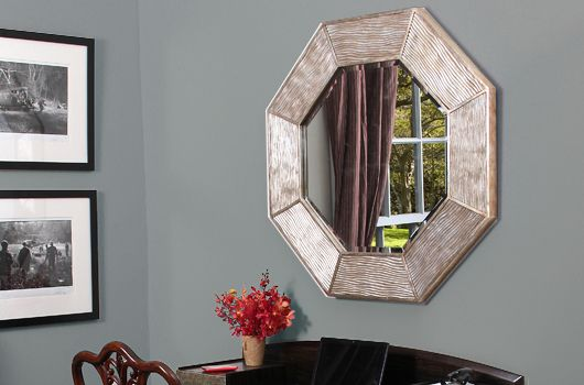 The silver Lennox Octagon Mirror. Timeless, stylish and contemporary, this mirror is hand carved and cast in silver leaf antiqued ridges. Simple and beautiful, our Lennox mirror works well as a hall mirror above a console table or a mantelpiece mirror in both contemporary and more traditional home interiors.