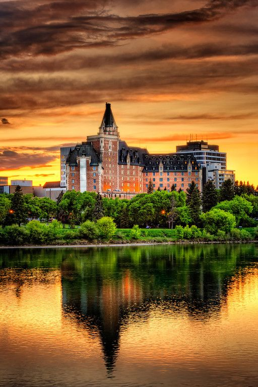 A golden orange sunset over the Bessborough Hotel and the South Saskatchewan River.