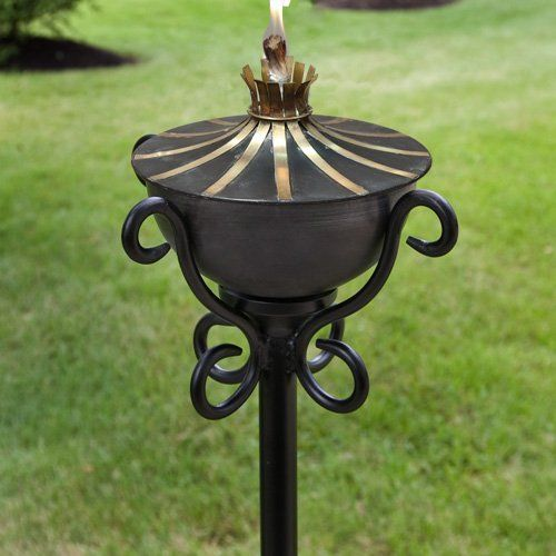 Brass Accented Zinc Garden Torch with Scroll Floor Stand - Set of Two - Weathered Zinc . $235.95. Instantly add a unique appeal to your outdoor patio area with this rustic style Brass Accented Zinc Garden Torch with Scroll Floor Stand. This garden torch set is perfect for a patio, deck or walkway in your outdoor living area. Torch is made of zinc. Weathered Zinc finish. Stand has a Black finish. Overall dimensions: 14-1/2 L x 14-1/2 W x 52 H. Stand pole is 1 diam...