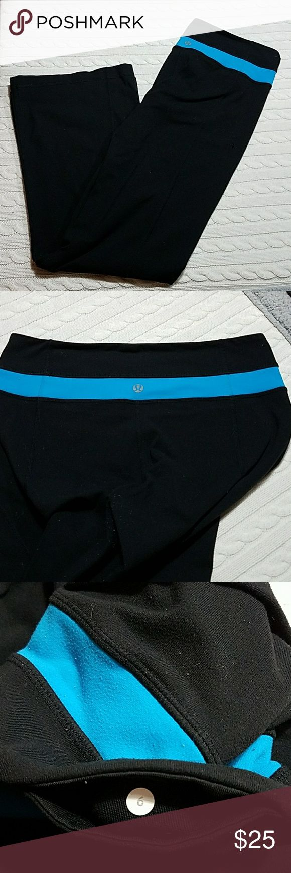 """Lululemon Yoga wide pant Sz 6 Black with turquoise stripe at waist. Pocket for key. Widest part of leg measure about 9"""" see pic 5. Some piling by crotch area see pic 7 and some from inside of the pant waist see pic 8. Very Comfortable pant. lululemon athletica Pants Leggings"""