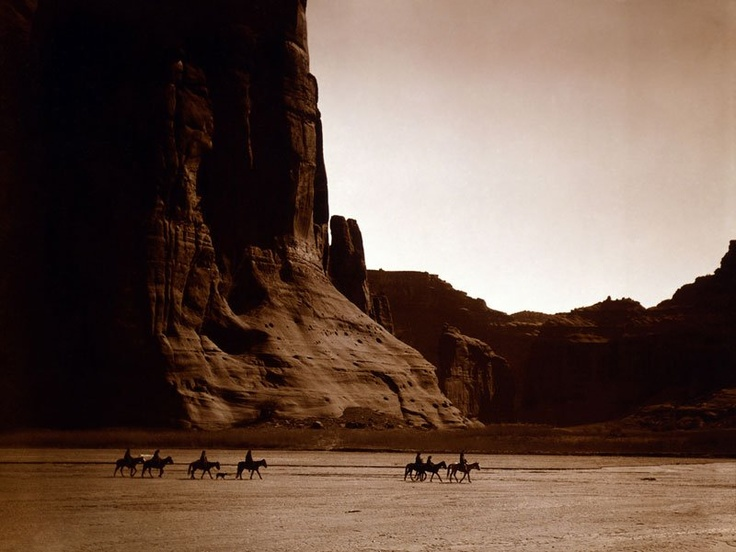 CANYON RIDERS Photograph by Edward S. Curtis In this beautiful photograph by E.S. Curtis (1862-1952), taken in 1904, we see seven Navajo riders on horseback and a dog trekking across the Canyon de Chelly.