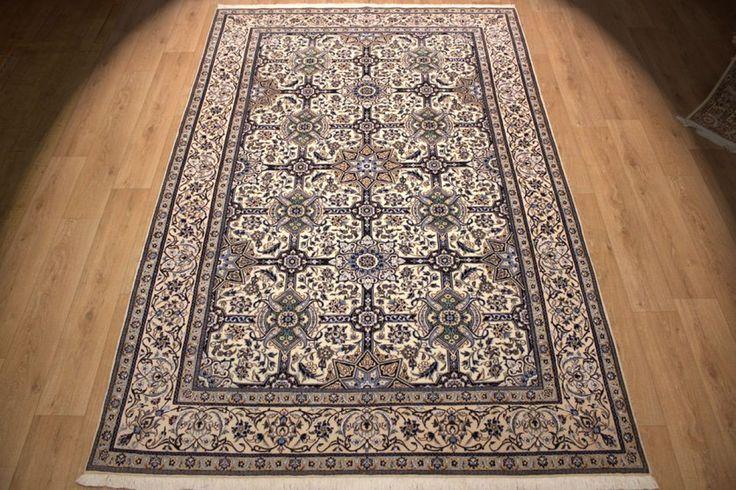 http://www.teppich.com/Classic-carpets/Persian-carpet-Nain-9la-with-Silk-311x205-cm::1412.html