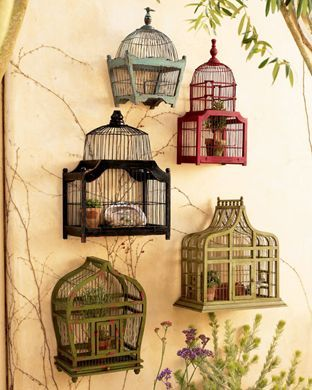 Decorate a bare wall with painted wooden birdcages for a whimsical effect.