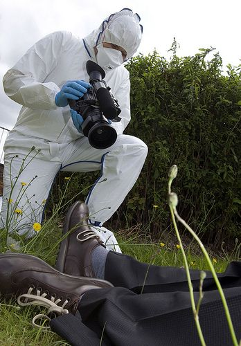 A Greater Manchester Police crime scene investigator (CSI) of the Force's Forensic Services Unit video records a mock crime scene as part of a training exercise.  CSIs spend many painstaking hours searching crime scenes and recording any evidence found. Their expertise plays a major role in bringing many offenders to justice.