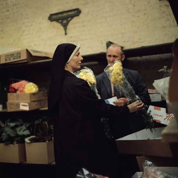 Nun buying flowers, Old Covent Garden Market, London