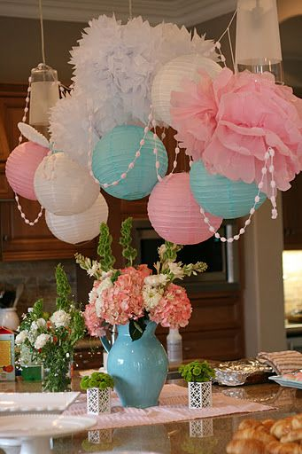 "tissue flowers and paper lanterns to make an inexpensive ""chandelier""...after the party, hang it in a nursery, kids room or playroom."
