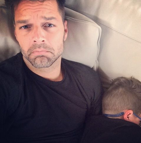 Ricky Martin with her son Valentino, who isn't happy about not getting his way