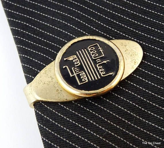A nice ebayer informed me that this is actually a constant voltage transformer made by the Sola company. This tie clip was most likely a promotional item. How cool is that?  #thetiechest