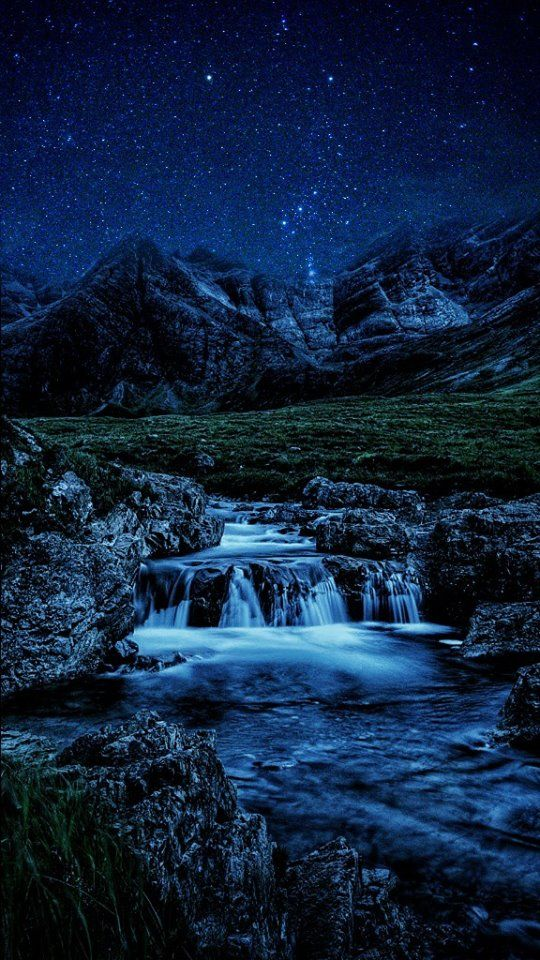 The Fairy Pools under the stars on the Isle of Skye in Scotland.