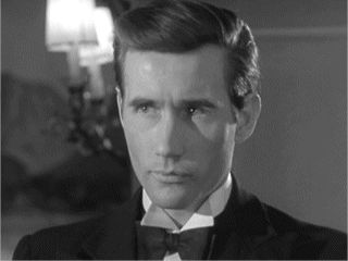 A very young and dapper Jim Dale.