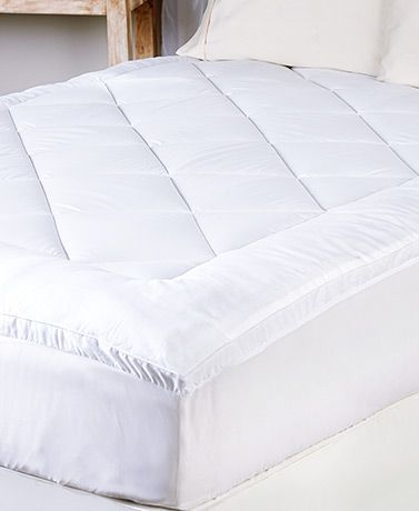 Experience the luxurious comfort of sleeping on a cloud with this Waterproof Pillow-Top Mattress Pad. It features diamond stitching that keeps the fill in place