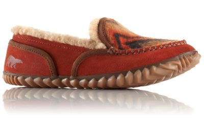 Eye-catching Tremblant is the perfect slipper-shoe indoors or out. Suede leather and chevron printed wool blanket upper is lined with cozy wool/acrylic blend fleece and rests atop a removable EVA footbed with heel cap and arch support. Tough rubber outsole with herringbone design adds grit to this laidback lady.