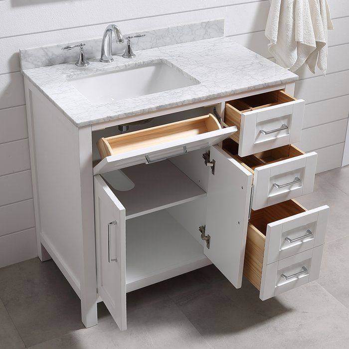 "The Tahoe vanity is the perfect solution big storage in a smaller space. Attention to detail and functionality are what really make this piece special. From drawers with built-in organizers to a flip-down front drawer, we made sure to utilize every inch of storage space. The Tahoe is appropriately complimented by modern chrome pulls and soft-close hinges and drawer glides. In addition a large 20"" under mount ceramic sink topped with lavish Carrera white marble for a truly astonishing overall…"