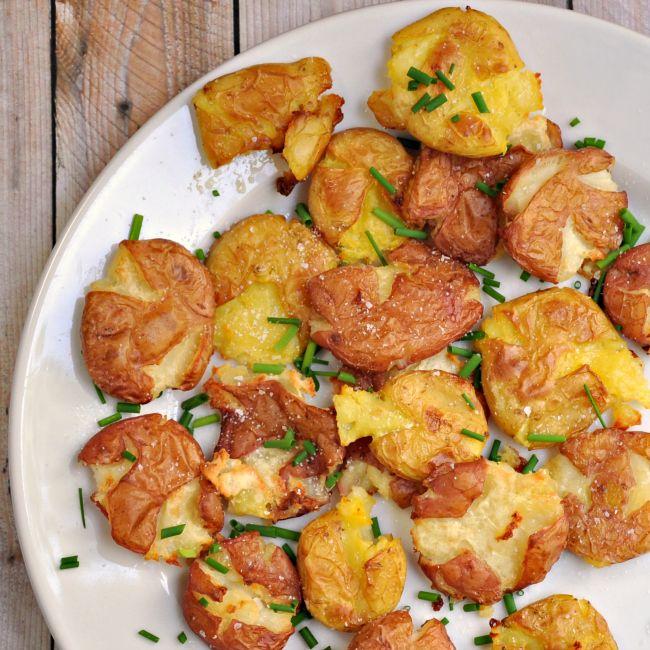 Crispy Salt and Vinegar Smashed Potatoes Recipe Side Dishes with baby potatoes, white vinegar, unsalted butter, kosher salt, olive oil, ground black pepper, chopped fresh chives, sea salt flakes