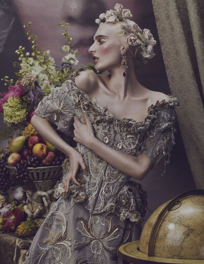 Ornate expectations at How to Spend it: The worlds of interiors and fashion come together to revel in the extravagant materials and intricate ornamentation of baroque. Styling by Damian Foxe. Photographs by Andrew Yee. Mary wears embroidered silk top and matching skirt, both by Vivienne Westwood. Dresden-style Compotes centrepiece (on table) from Regent Antiques. Canvas wall mural reproducing Manon Balletti by Jean-Marc Nattier from the National Gallery Collection by Surface View.