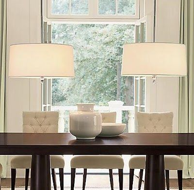 Modern And Traditional Dining Table Set Up Double Pendant Drum Lights With Vase Centerpieces