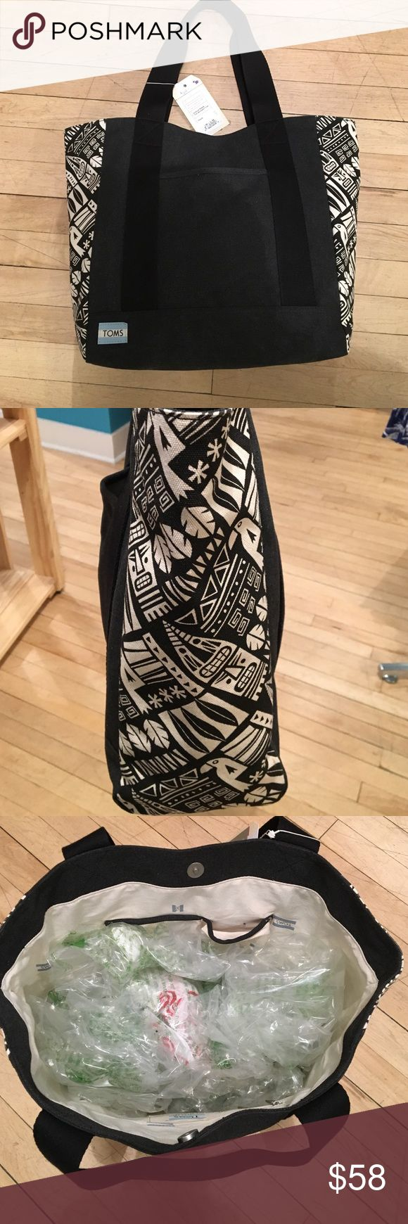 Toms Aztec tote bag Super cute and spacious! New with tags. One putter pocket. One inner zipper. Two inner pockets. Toms brand. Toms Bags Totes
