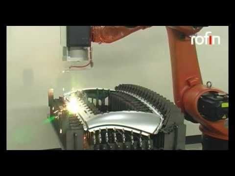 Robotically guided laser scanner welding of automotive parts with ROFIN solid-state lasers. 100 welds in 50 seconds. Laser welding system for 2D and 3D welding applications.