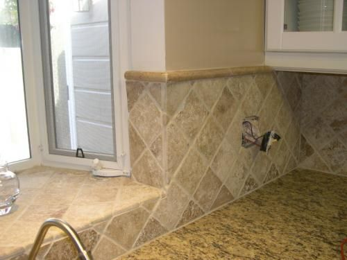 The contractor who does our granite is also going to redo our kitchen backsplash. I want these stones used on an angle like this picture shows.