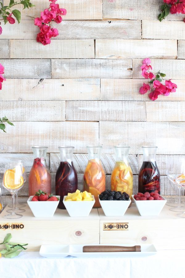 Tips and tricks for setting up a Sangria Bar, the perfect drink station for weddings, parties, and celebrations! Plus, tons of inspirational images!
