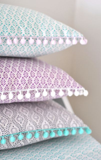Pom pom trim cushions, via Flickr. Would love in different colors!