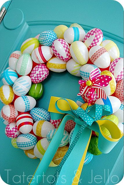 Yet another use for washi tape--Easter Egg Wreath made with washi tape on white plastic eggs. So cute!!