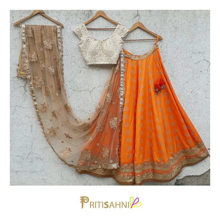 A chic summer wedding look.Look radiant in this orange and offwhite lehenga set on your Sangeet and Mehendi day For more information write to info@pritisahni.com . 18 June 2017