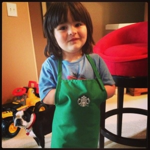 These kids-sized Starbucks aprons came into corporate HQ's retail store last week, they are SO CUTE!  I don't think the first shipment will last long.
