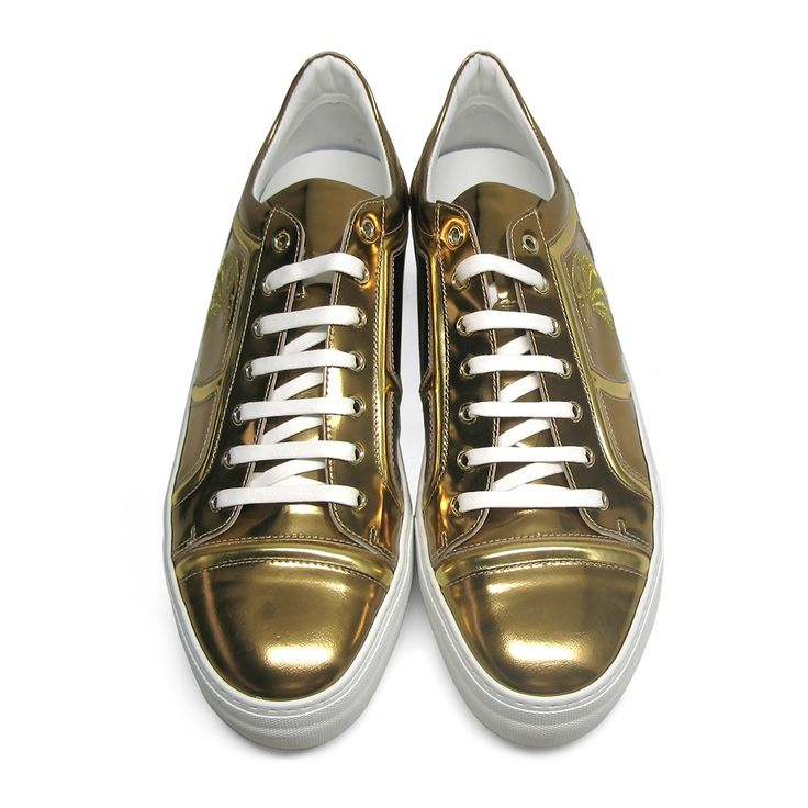Fabulous Billionaire sneakers in gold metallic leather for a luxe statement. An embroidered falcon sits on the side of this design with contrasting laces and a platform sole. Size: 43.Made in Italy.