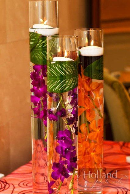 Lovely orchid centerpiece display accented with floating candles.