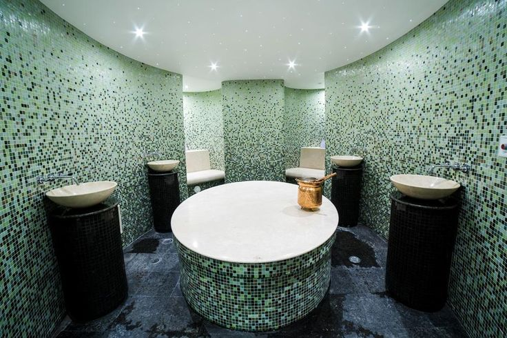 Calm, luxurious and radiant with light with our custom glass mosaics
