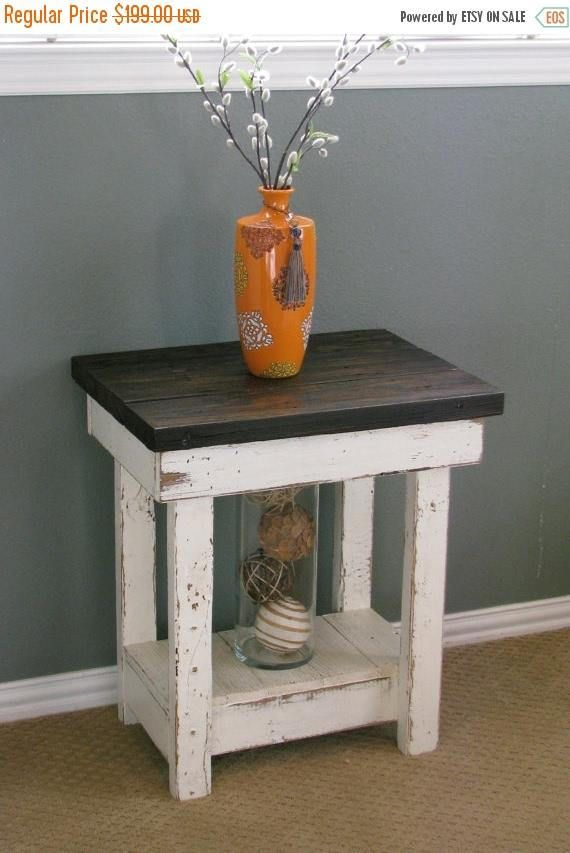 This beautiful detailed white distressed end table measures 23L x 16W x 26H and is made from reclaimed wood and will add a fun pop to your home. The top has been sanded smooth, stained and finished with poly for a beautiful sealed finish along with wooden plugs for extra rustic