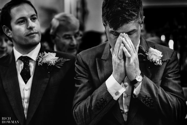 The Groom taking an emotional  moment before getting married  at the Holy Trinity Church in Westbury on Trym
