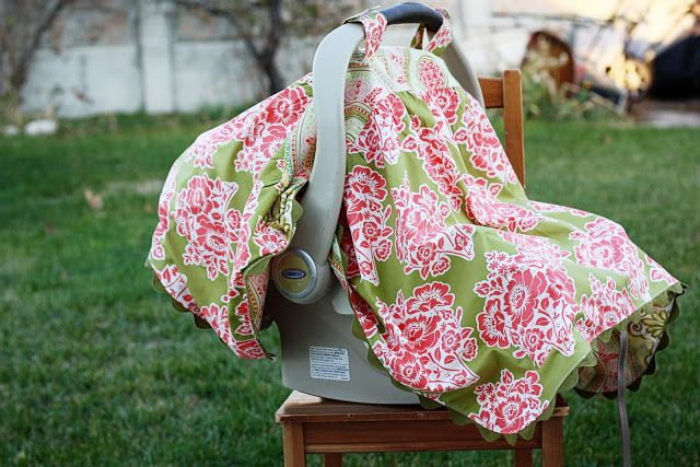 http://www.sewmuchado.com/2011/11/gathered-car-seat-canopy-tutorial.html