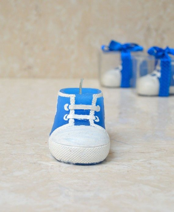 ust right for baby shower favors or as announcement gifts . each baby bootie candle favor  is made of wax with a classic sneaker design and painted laces, soles and details. , each comes packaged in a clear plastic box tied with a blue satin ribbon