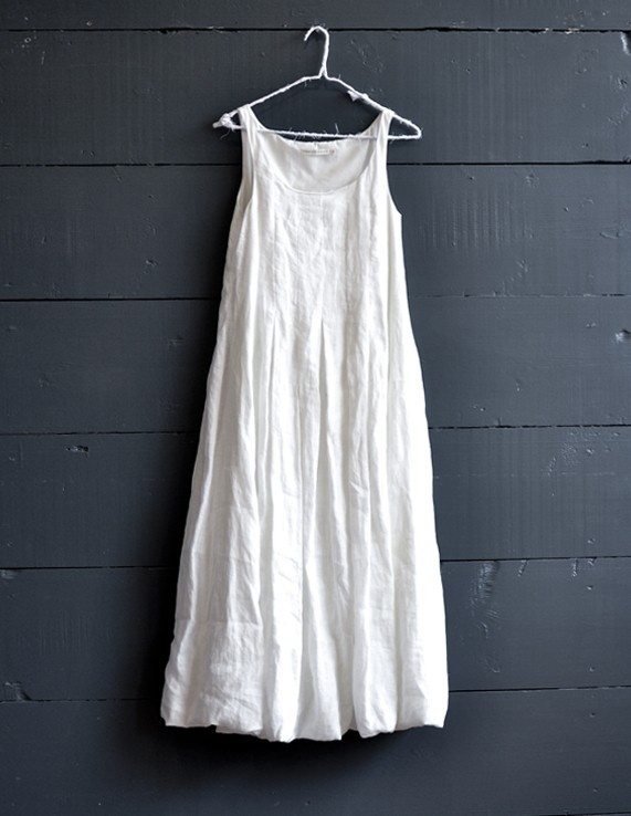This beautiful long dress from Cabbages and Roses is a key piece for summer. Made from 100% white linen, it has stitch detailing across the bust and a soft bubble hem, with a full ankle length skirt creating lots of movement. Made in London.