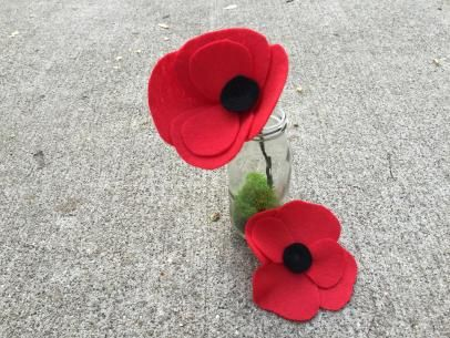 Poppies are normally a Memorial Day tradition, but these easy fabric flowers from DIY Network are a great decoration anytime of year.  Check out the instructions on how to make a poppy pin and a stemmed flower.