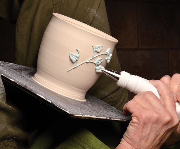 Slip trailing is a great way to add decoration to pots. Most ceramic artists use a fairly liquid slip when slip trailing. But after watching a baking compe