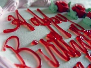 * Use wax paper to decorator cakes like a professional. Cut a piece of wax paper the same size as your cake, using the cake pan as a guide.  Write directly on the paper instead of the cake and freeze it.  Gently peel the frozen letters and words off the paper and place them on the cake.