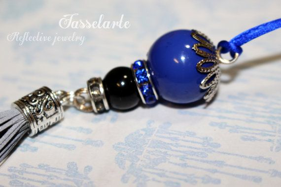 Reflective tassel, life saving handmade pendant charm to a purse, coat, backbag etc