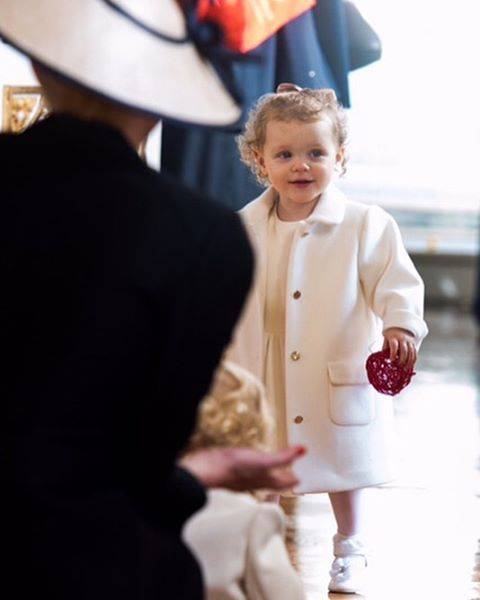 Her Serene Highness Princess Gabriella of Monaco in an off-white #ArmaniJunior dress and matching coat for Monaco's annual National Day celebrations in Monte Carlo. #ArmaniStars