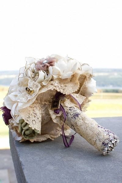 This bride took the lace from her mother's wedding dress and wrapped it around her bouquet.