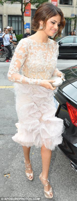 Naked ambition: Selena's dramatic dress had a nude effect top with strategically placed jewels