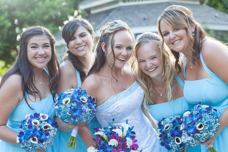 We love the joy in this photo #Disney #wedding #bridesmaids #blue I LOVE THE COLORS/FLOWERS/BLUE EDGE AROUND THE TOP OF THE DRESS (: