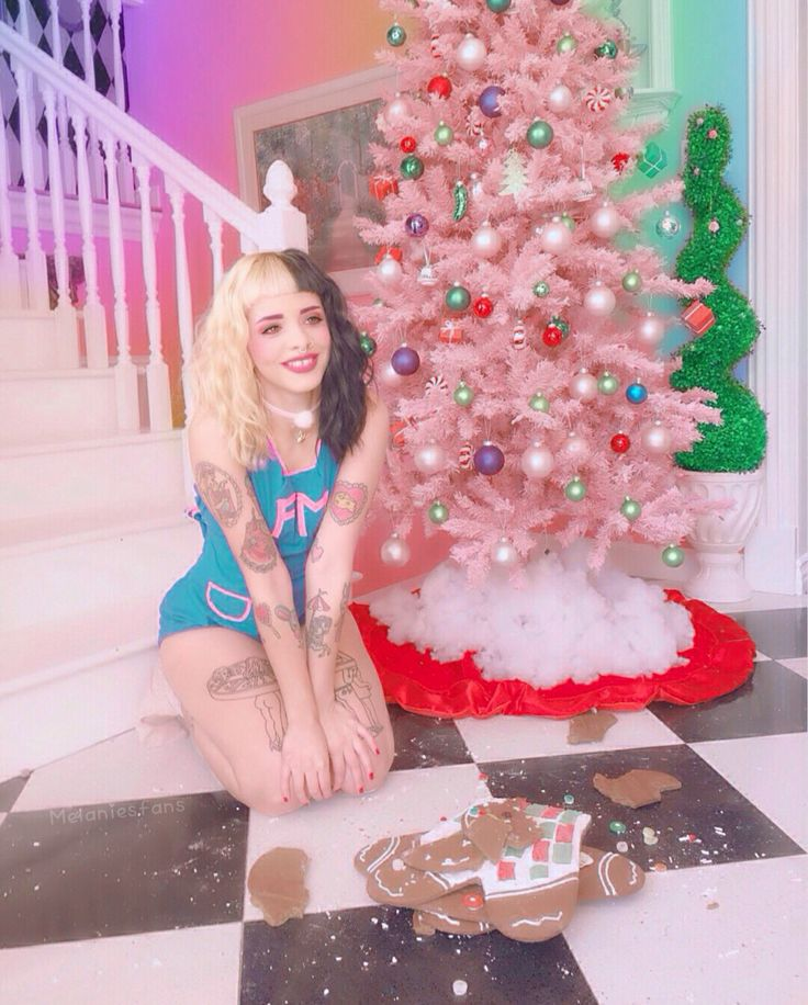 "Melanie Martinez posing with gingerbread man from her new Christmas song ""Gingerbread Man"""