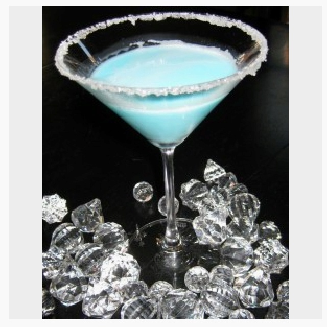 Silent Night Martini!: 1/4 c. Malibu Rum, 1/4 c. pineapple juice, 1/8 c. blue curacao, 1/8 c. white creme de coacoa, dash or two of whipping cream~ rim a martini glass with sugar, add all ingredients with ice- shake and pour!