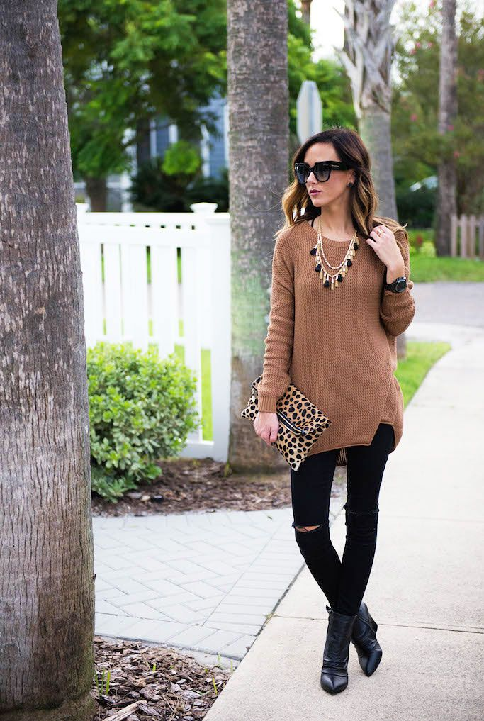 camel tunic sweater, destructed black skinny jeans, leopard clutch, black booties
