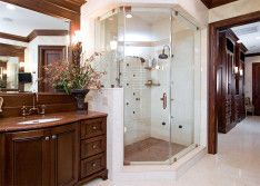 Transparent Glazed Shower Area In Luxury Bathroom Corner Next To Wooden Shelf With White Washbasin And Mirror