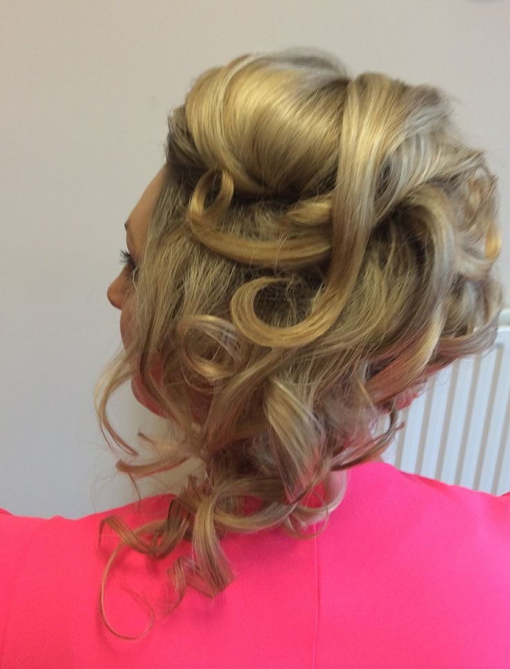 Soft ghd curls pinned into an updo