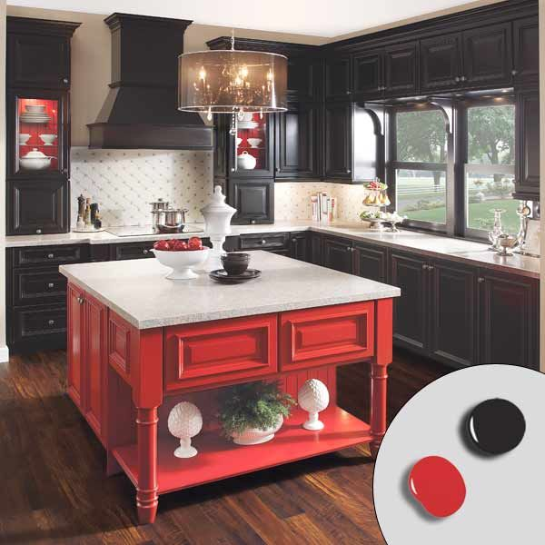 This dramatic kitchen by KraftMaid feels balanced thanks to a pairing of equal-intensity colors. Black cabinets effectively fade into the background to show off the red island at center, while a light backsplash and countertops keep the painted pieces from feeling heavy. For a similar look, try: Red Gumball (red) and Phantom Mist (black) by Olympic. | Photo: Courtesy of KraftMaid Cabinets | thisoldhouse.com